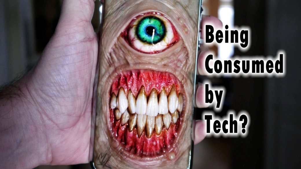 "Beast face on a phone captioned with ""Being Consumed by Tech?"""