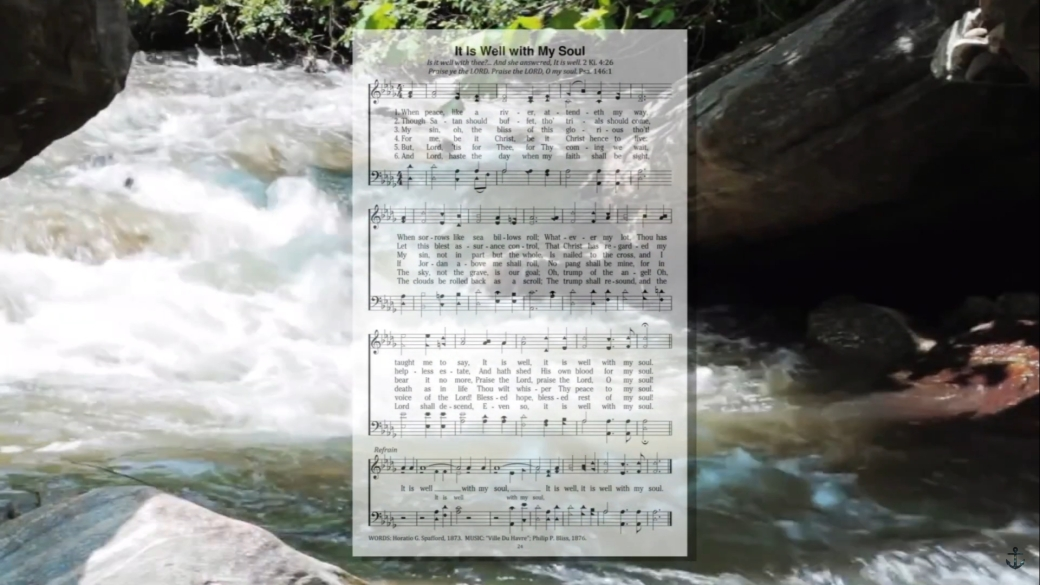 A river rapids with sheet music for It Is Well with My Soul overlapping.